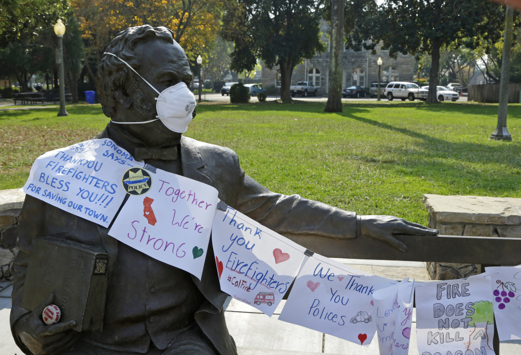 A statue of General Vallejo with a mask on his face as well as notes of thanks to fire fighters is seen in Sonoma Square on Wednesday, Oct. 18, 2017, in Sonoma, California.