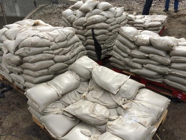 George Rodriguez, 69, a volunteer, loads sandbags at the Glendora City Yard.