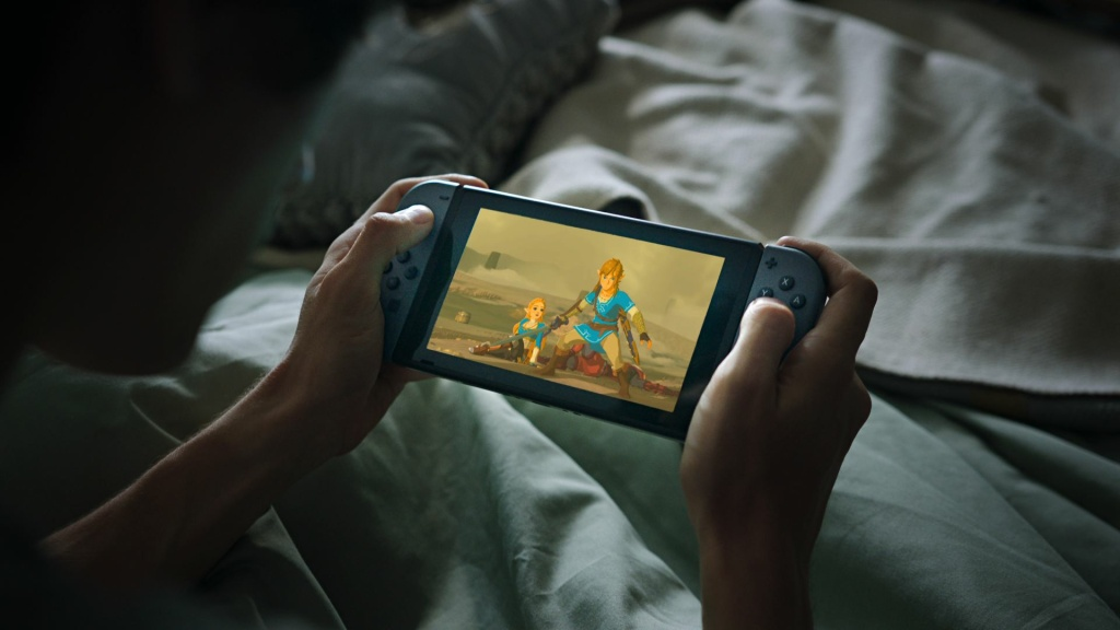 A promotional shot of the Nintendo Switch, a video game console capable of literally being picked up and taken on the move without sacrificing the playing experience.