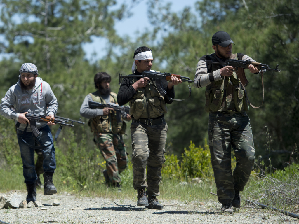 Rebel fighters from the Al-Ezz bin Abdul Salam Brigade attend a training session at an undisclosed location near the al-Turkman mountains, in Syria's northern Latakia province, in April.