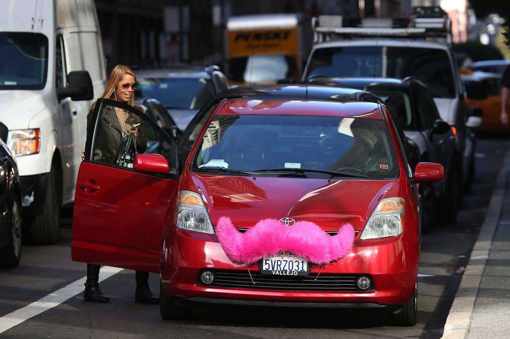 The California Public Utilities Commission is scheduled to vote on a proposal Thursday changing the insurance requirements for companies like Lyft.