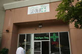 A man enters Private Organic Therapy (P.O.T.), a non-profit co-operative medical marijuana dispensary in Los Angeles, Calif.