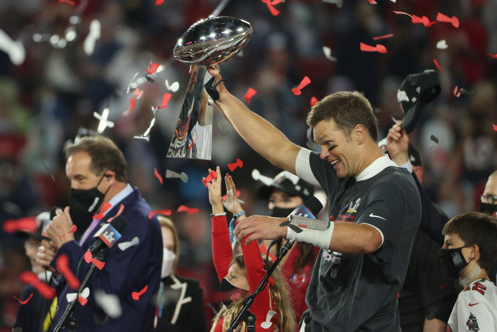 Tom Brady #12 of the Tampa Bay Buccaneers hoists the Vince Lombardi Trophy after winning Super Bowl LV at Raymond James Stadium on February 07, 2021 in Tampa, Florida.