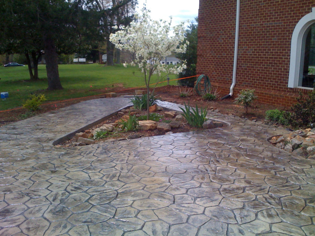 Concrete (pavement) - 8 Options For Replacing Your Lawn, Along With Their Pros And Cons