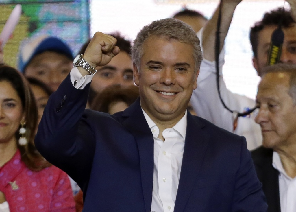 Colombia's President-elect Ivan Duque celebrates his victory in the presidential runoff election, in Bogota, Colombia, Sunday. Duque defeated Gustavo Petro, a former leftist rebel and ex-Bogota mayor.