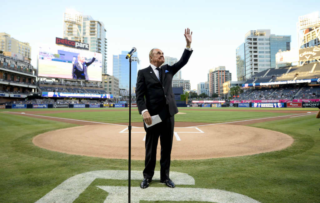 San Diego Padres announcer Dick Enberg waves to the crowd during a ceremony held before a baseball game between the San Diego Padres and the Los Angeles Dodgers at PETCO Park on September 29, 2016 in San Diego, California.