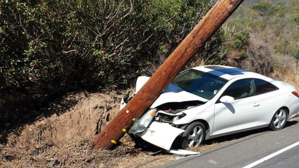 A car that crashed into a power pole, causing a power outage in Malibu on Saturday, Aug. 16, 2014.