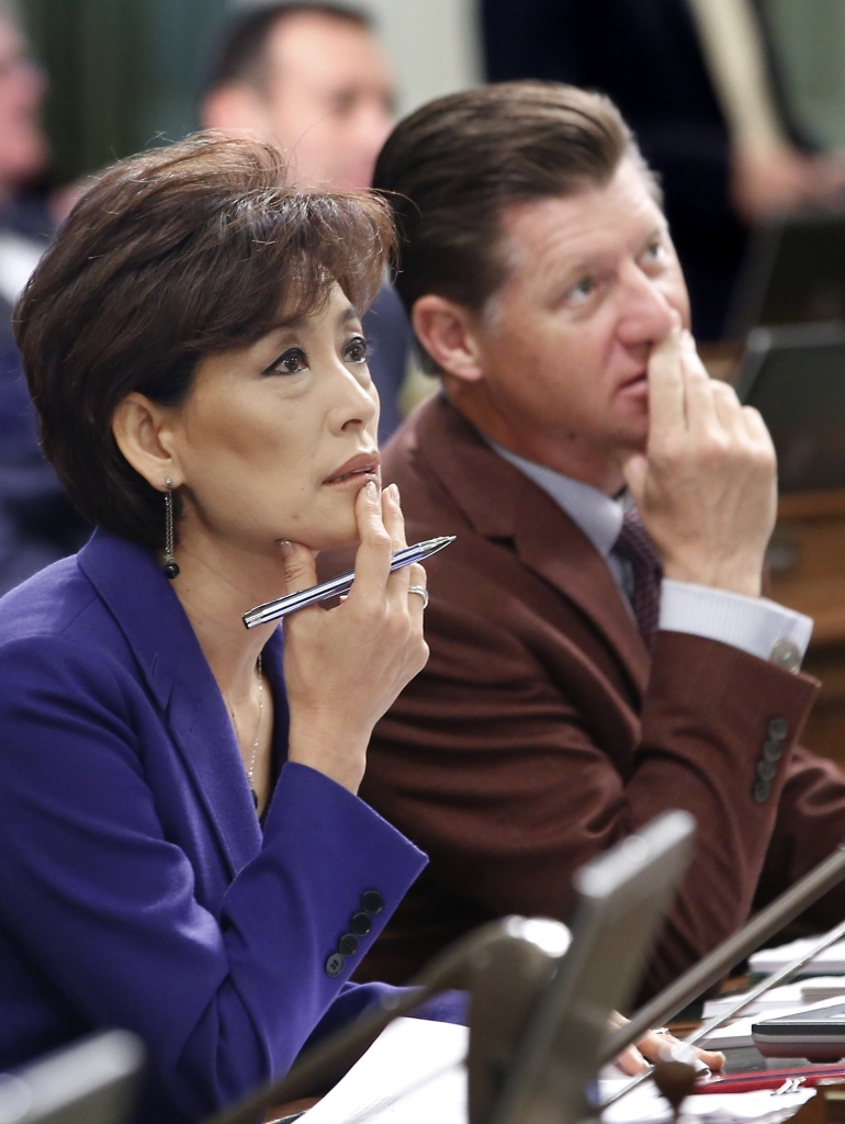 FILE - In this June 19, 2015, file photo, Republican Assembly members Young Kim, of Fullerton, and Brian Jones, of Santee, watch as the votes are posted for the revised budget plan up for consideration at the Capitol in Sacramento, Calif. Kim's campaign says someone stole 30 tablets and a laptop computer from her Orange County campaign office.