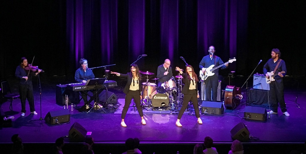Nancy and Beth (Megan Mullally and Stephanie Hunt) in performance with their band.