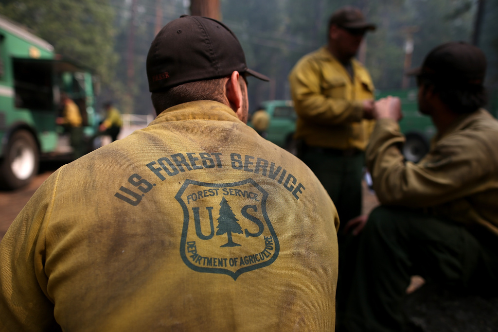 U.S. Forest Service firefighters take a break from battling the Rim Fire at Camp Mather on August 25, 2013.