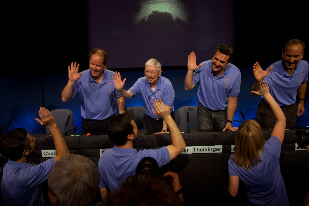 Members of the project leadership team pass out high fives to engineers from mission control before a press conference at the Jet Propulsion Laboratory Sunday night. At $2.5 billion, the Curiosity mission equals what NASA has given to SpaceX in funding.