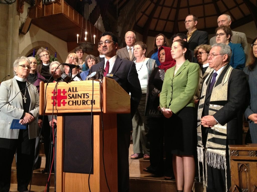 Salam Al-Maryati of the Muslim Public Affairs Council joins faith leaders at All Saints Church