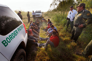 U.S. Border Patrol officers stop a group attempting to cross the U.S./Mexico border