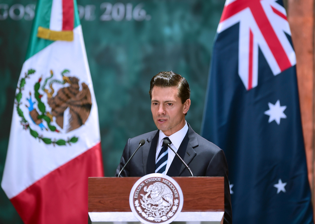 Mexican President Enrique Pena Nieto delivers a speech during the welcoming ceremony in honour of Australian Governor-General Sir Peter Cosgrove (out of frame) at the National Palace in Mexico City.