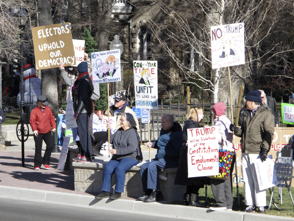 Protesters demonstrate against then President-elect Donald Trump outside the State Capitol building in Carson City, Nev. in Dec. 2016 while Nevada's six Democratic presidential electors inside cast their official Electoral College ballots for Hillary Clinton.