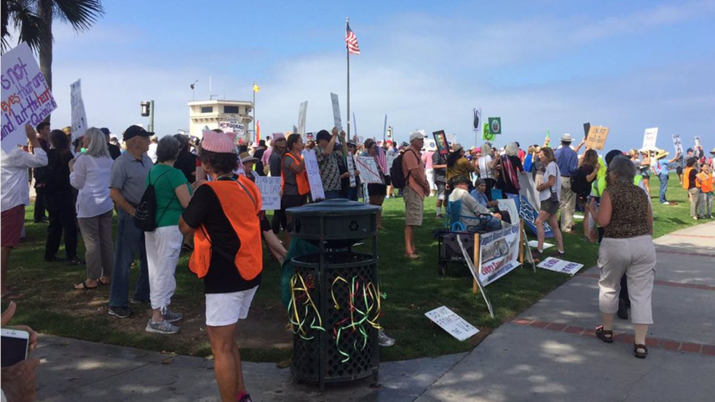 Hundreds of people rallied at Laguna Beach on Saturday, Aug. 19, to condemn racism after the deadly events in Charlottesville, Virginia.