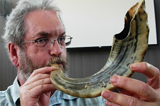 Michael Chusid, who says he's taught thousands of people to blow the shofar. He calls himself a shofar