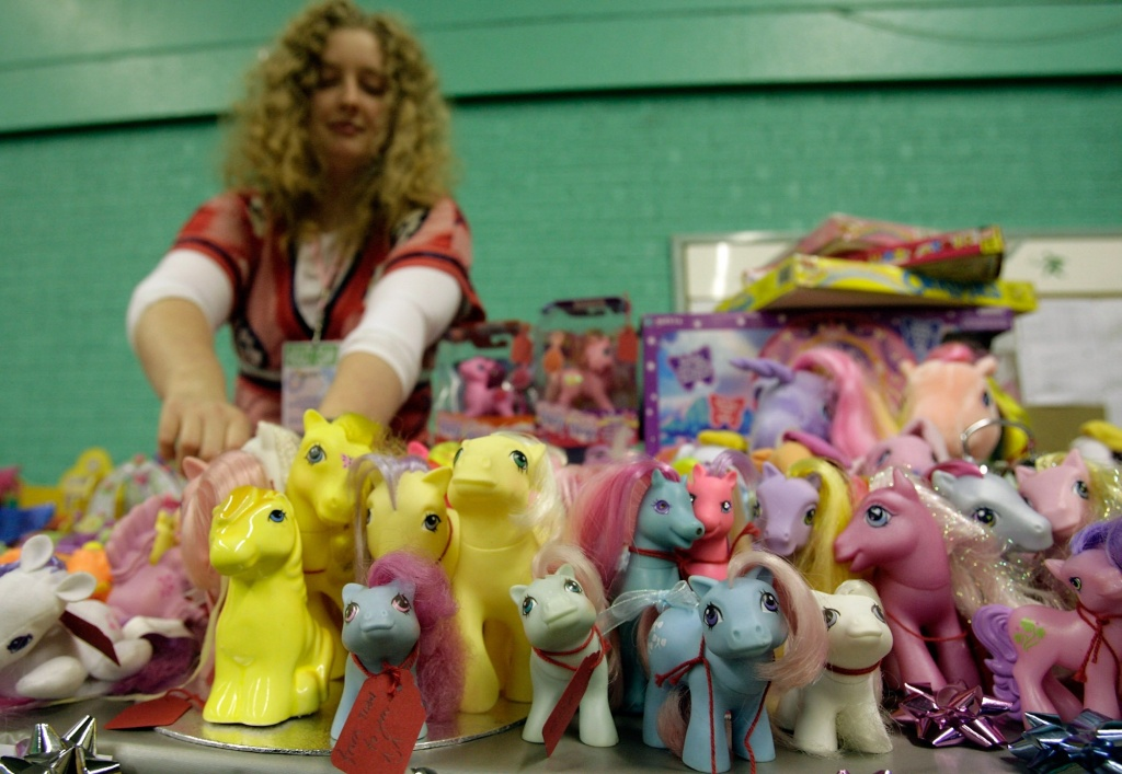 Helen Park, a avid collector, adjusts her My Little Ponies as they are  displayed at the International My Little Pony Convention at Redwood Hotel and Country Club, on October 26 2007 in England.