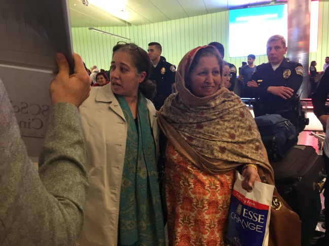Nalia Shah of Rolling Hills, right, greets her 65-year-old mother, Rabia, at LAX on Saturday, Jan. 28, 2017. Her mother and father are green card holders traveling from Pakistan, a country not on the list targeted by President Trump's ban on Muslim-majority countries. Nonetheless, they were kept waiting for four hours before released.
