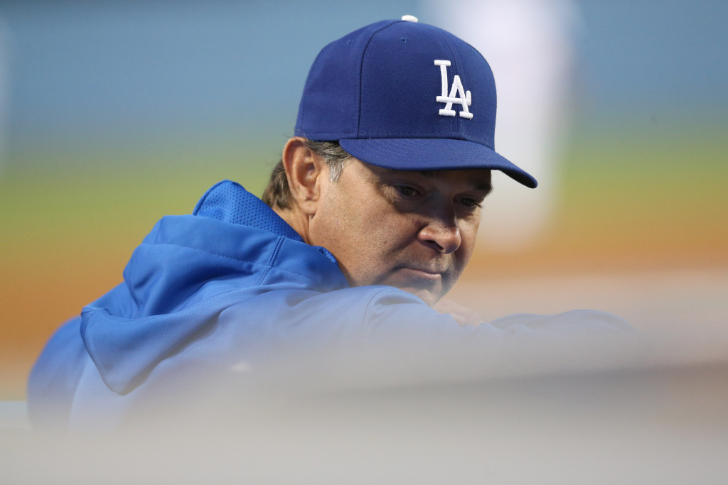 Manager Don Mattingly of the Los Angeles Dodgers looks on from the dugout during the game with the Arizona Diamondbacks at Dodger Stadium on May 6, 2013 in Los Angeles.