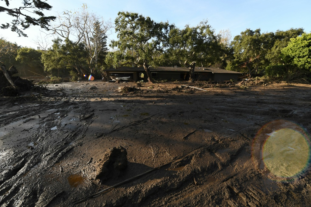 A home is surrounded by mud and debris caused by a massive mudflow in Montecito, California, Jan. 10, 2018.