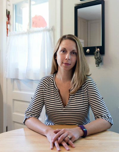 Meg Whitbeck, 34, at her home in Ridgefield, Conn. She says she is grateful for orphan drugs but torn on the issue of price.