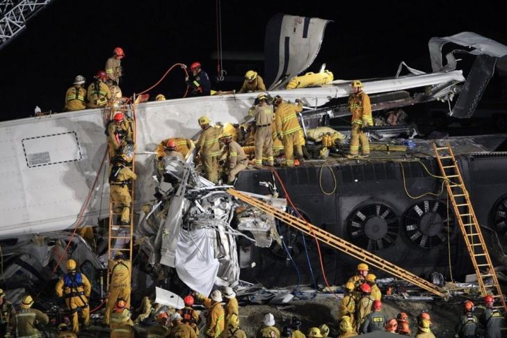Firefighters search for survivors in the wreckage of a Metrolink commuter train that collided head-on with a freight train on the previous afternoon, on Sept. 13, 2008 in the Los Angeles area community of Chatsworth.