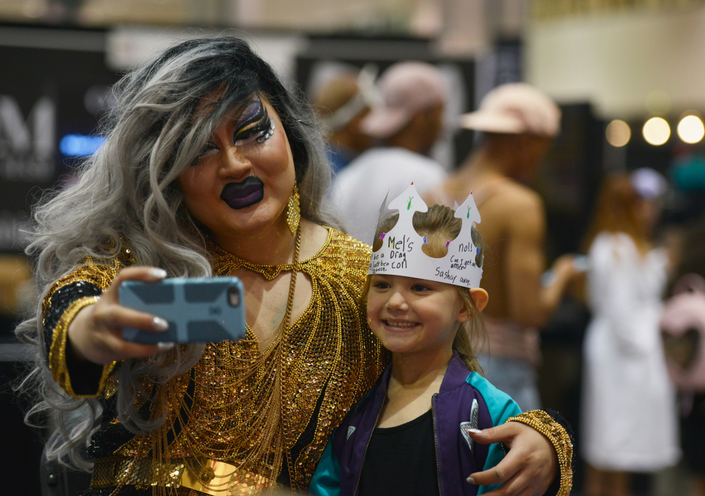 Attendees take pictures during RuPaul's DragCon at the Los Angeles Convention Center on April 30, 2017.