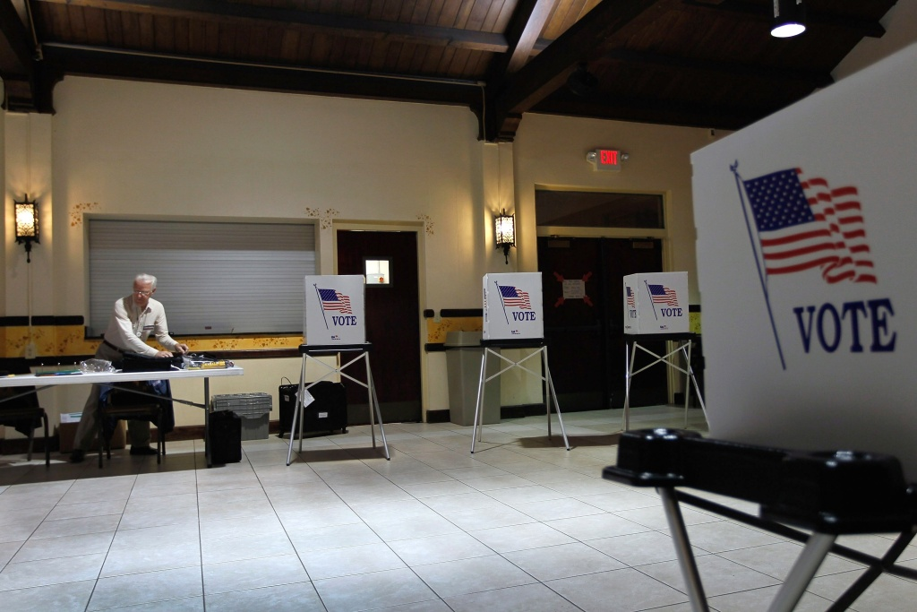 Ray Roy sets up a polling station as they prepare for voters on primary day on January 31, 2012 in Tampa, Florida.