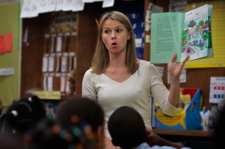 Teacher Amanda Morton reads a story to kindergarten students at Harlem Success Academy, a free, public elementary charter school in the Harlem neighborhood of New York City on March 30, 2009.