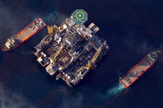 An oil platform and ships sit at the site of the Deepwater Horizon well head operated by BP on May 6, 2010 in the Gulf of Mexico.