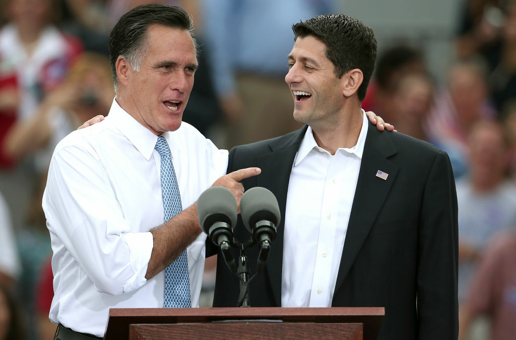 NORFOLK, VA - AUGUST 11:  Republican presidential candidate, former Massachusetts Gov. Mitt Romney (L) jokes with U.S. Rep. Paul Ryan (R-WI) (R) after announcing him as the
