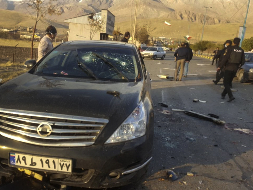 This photo released by the semiofficial Fars News Agency shows the scene where Mohsen Fakhrizadeh was reportedly killed in Absard, a small city just east of Tehran, Iran, on Friday. Fakhrizadeh, an Iranian scientist that Israel alleged led the Islamic Republic's military nuclear program until its disbanding in the early 2000s, was