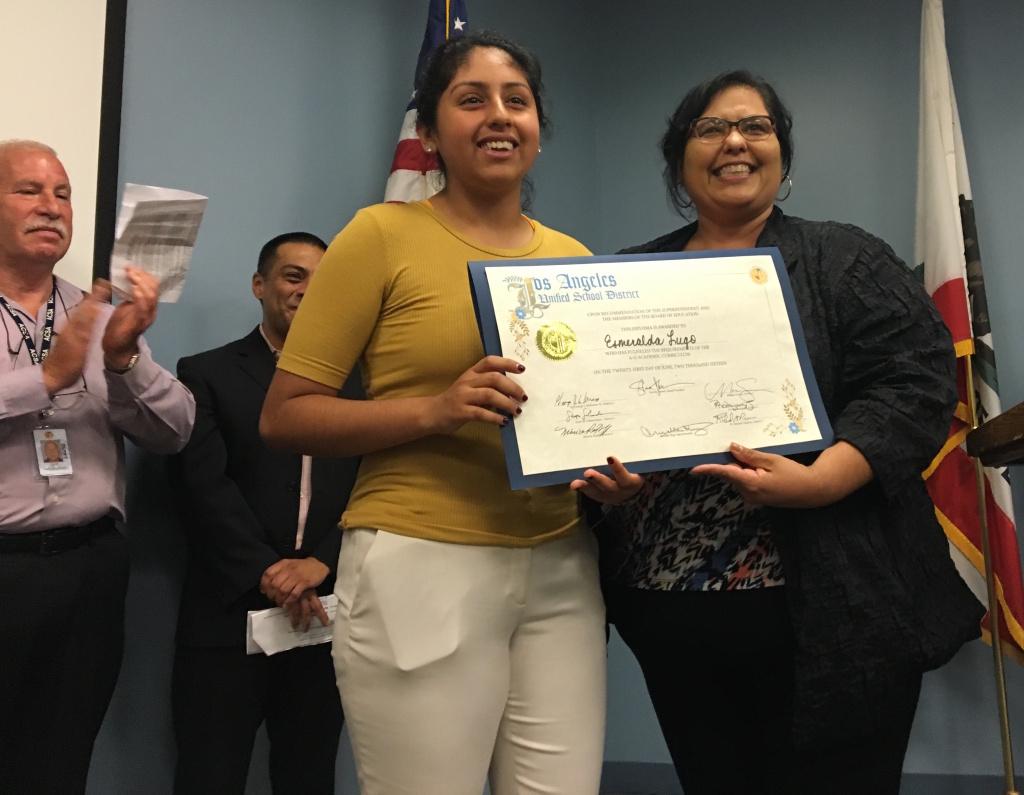 Los Angeles Unified School Board member Mónica García congratulates recent graduate Esmerelda Lugo during a ceremony at the district's headquarters on Tuesday, June 21, 2016.
