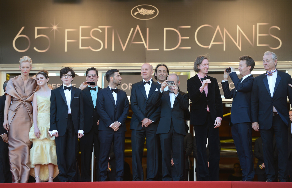 (L-R) Actors Tilda Swinton, Kara Hayward, Jared Gilma, Roman Coppola, actor Jason Schwartzman, (from 4th-R) actor Bob Balaban, director Wes Anderson, actors Edward Norton and Bill Murray pose at the