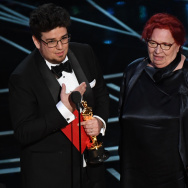 "hungarian editor Kristof Deak (L) and producer Anna Udvardy (C) deliver a speech on stage after they won the Best Short Film (Live Action) award for ""Sing"" at the 89th Oscars on February 26, 2017 in Hollywood, California. / AFP / Mark RALSTON        (Photo credit should read MARK RALSTON/AFP/Getty Images)"