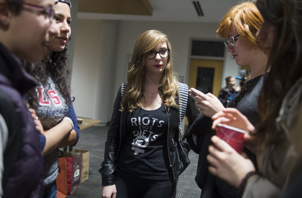 Amanda Gould (C), an American University student on a student government Sexual Assault Awareness and Prevention Task Force dealing with campus sexual assaults and violence, speaks with fellow students during a school forum about the issue at American University in Washington, DC, November 10, 2014.