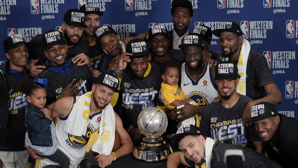 The Golden State Warriors pose with their trophy after defeating the Houston Rockets in Game 7 of the NBA Western Conference finals Monday in Houston.