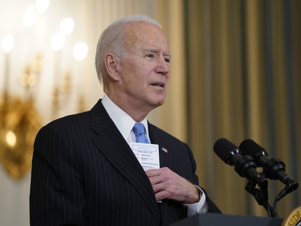 President Biden keeps a note card in his suit pocket with the running tally of how many Americans have died from COVID-19 and how many have been vaccinated.