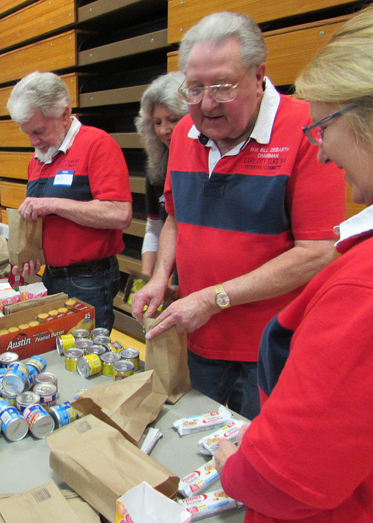 Bill Ziebarth (3rd from left) and other members of the Lake City Elks in Shoreline, Washington pack bags for homeless veterans at the Seattle Stand Down.