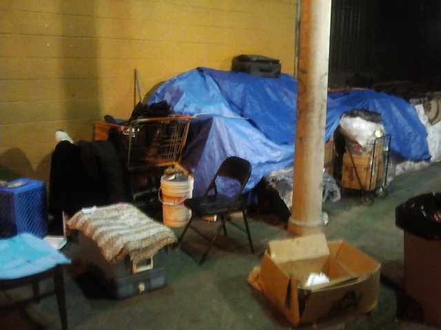 A homeless person's belongings are kept in a pedestrian walkway in Downtown Los Angeles.