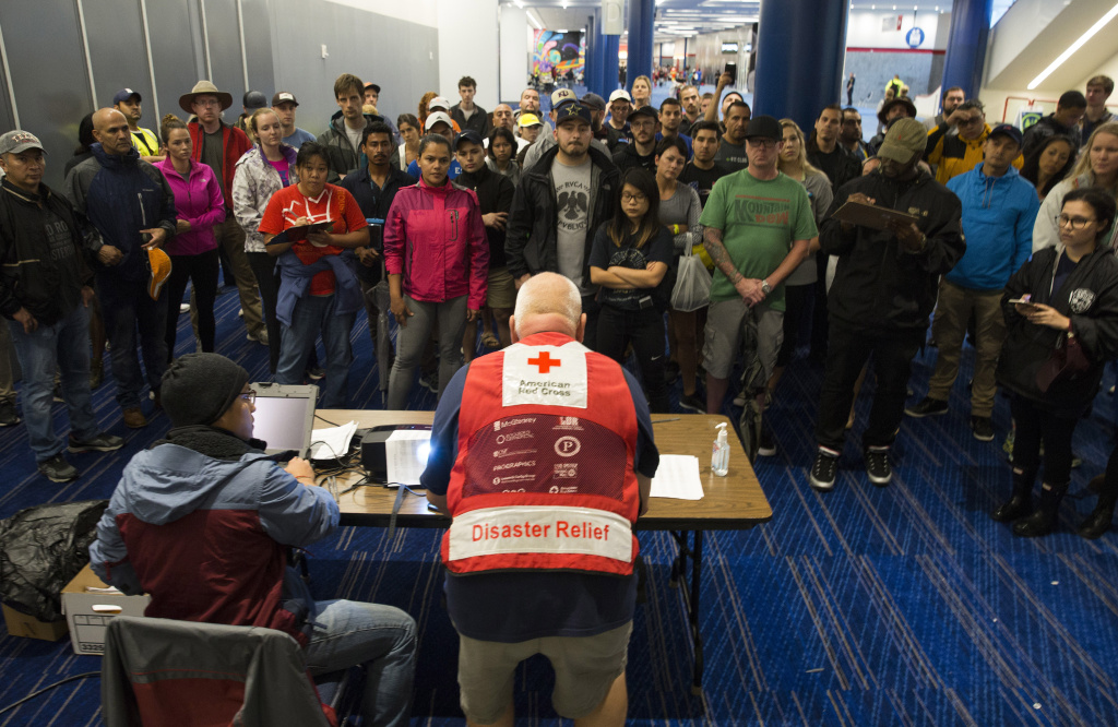 Volunteers get a briefing at the George Brown Convention Center that has been turned into a shelter run by the American Red Cross to house victims of the high water from Hurricane Harvey on August 28, 2017 in Houston, Texas.