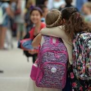 Girls hug each other outside the European school of Strasbourg in France.