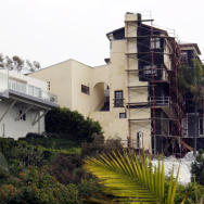 A large hillside home is seen next to a more traditionally-sized home in the Castellamare area of Los Angeles, one of the areas that could come under the jurisdiction of a new mansionization ordinance for hillside areas in the city, seen Wednesday, April 6, 2011. (AP Photo/Reed Saxon)