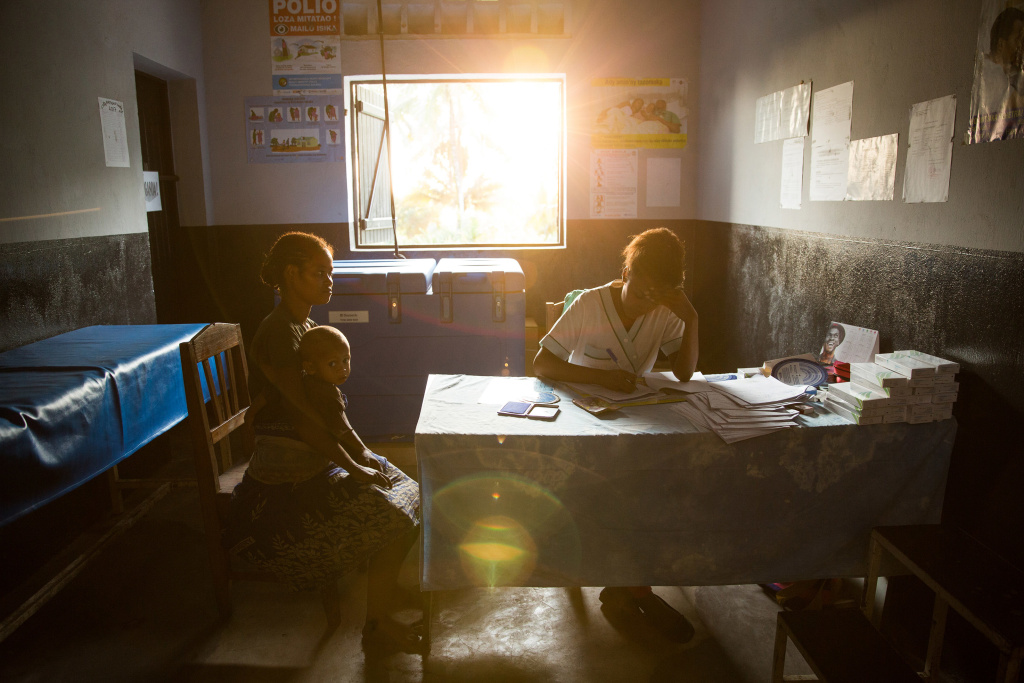 A patient talks with a nurse at a traveling contraception clinic in Madagascar run by the British nonprofit group Marie Stopes International. The organization is one of many that has decided to give up U.S. funding because it deems Trump's ban on providing abortion referrals to be ethically unacceptable.