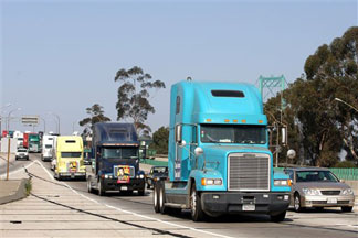 "File: Los Angeles and Long Beach independent port truck drivers convoy from Los Angeles to the Port of Long Beach in diesel trucks in support to the port's ""Clean Trucks Program,"" Wednesday, June 27, 2007, in Los Angeles as they push for cleaner air and better working conditions for drivers."
