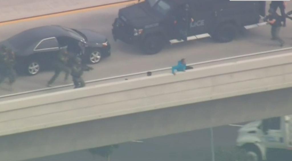 After a quick freeway chase and tense standoff, Daniel Perez was captured as he approached the edge of a San Diego freeway overpass.