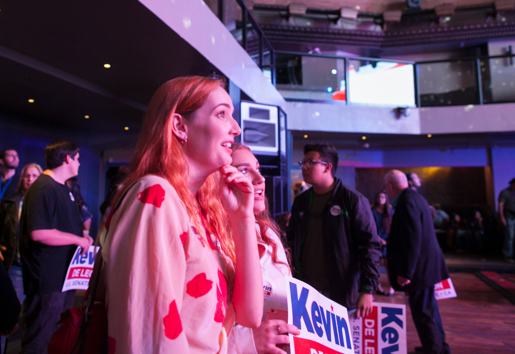 Elise Collins, left, and Haley Walters watch results come in at the Kevin de Léon watch party at Exchange L.A. on Tuesday, June 5, 2018.