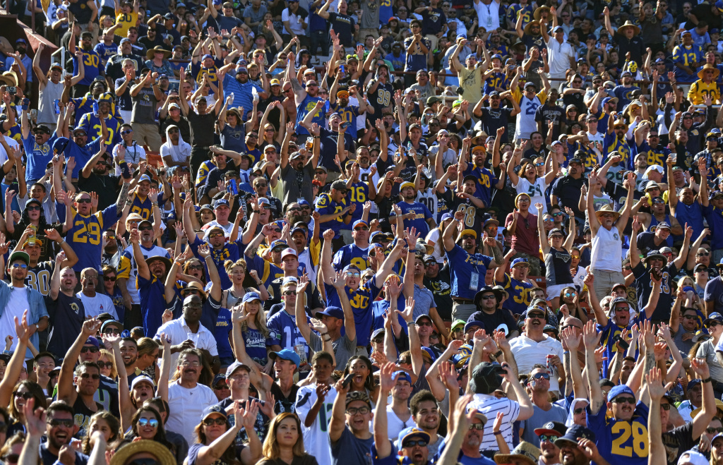 Los Angeles Rams fans cheer during the team's game with the Seattle Seahawks at the Los Angeles Memorial Coliseum on Sept. 18, 2016.