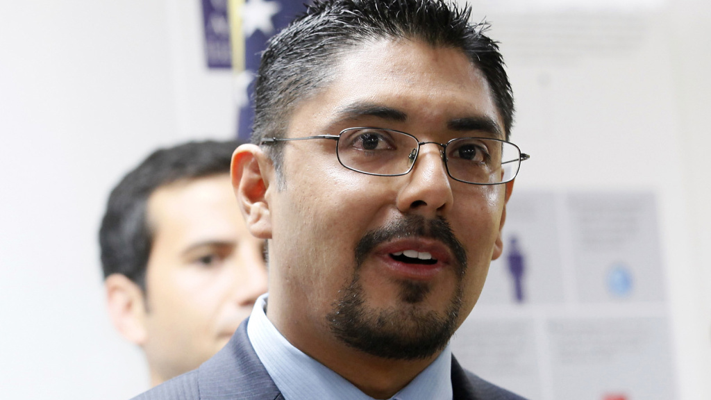 Sergio Garcia speaks at a press conference in LA in August. The state Supreme Court granted him admission to the State Bar, but he will have to practice independently because his lack of legal status bars law firms from hiring him.